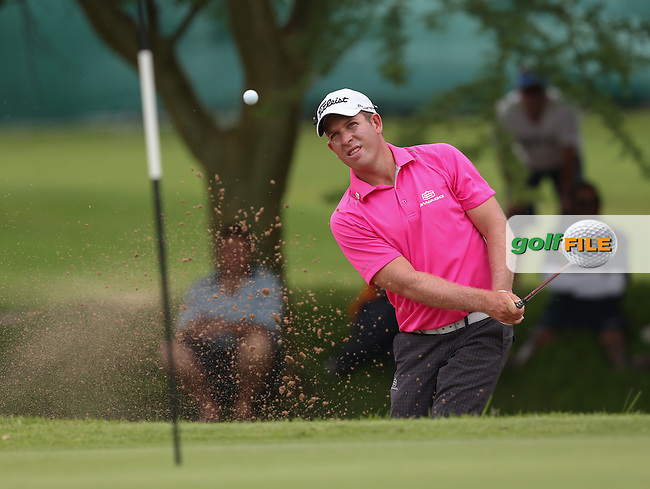 Oliver Bekker (RSA) plays a deft bunker shot to hold for par on the 15th during the Final Round of The Nelson Mandela Championship 2013 presented by ISPS Handa, at the Mount Edgecombe Country Club, KwaZulu-Natal, South Africa. Picture:  David Lloyd / www.golffile.ie