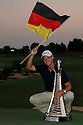 Martin KAYMER (GER) poses with the Race to Dubai Trophy after the final round of the Dubai World Championship presented by DP World, played over the Earth Course, Jumeira Golf Estates on 28th November 2010 in Dubai, UAE......