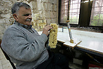 Palestinian blind men work in making brooms at a workshop in the Old City of Jerusalem on March 5,2011. The workshop is owned and managed by the Arab Blind Association, which was founded by blind Palestinians in 1932, and has then set up a number of workshops employing blind Arabs, as well as offering financial aid projects to blind. Photo by Mahfouz Abu Turk