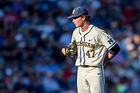 Michigan Wolverines pitcher Tommy Henry (47) looks to his catcher for the sign against the Vanderbilt Commodores during Game 1 of the NCAA College World Series Finals on June 24, 2019 at TD Ameritrade Park in Omaha, Nebraska. Michigan defeated Vanderbilt 7-4. (Andrew Woolley/Four Seam Images)