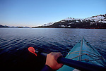 Alaska, Sea kayaker explores Alaska's Prince William Sound's Knight Island Passage.