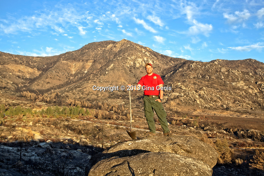 Tony Sandrini at a burn area in Apple Canyon with the Zen Center in the background behind the only remaining trees they saved.