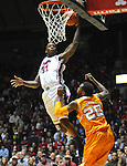 "Mississippi's Murphy Holloway (31) scores over Tennessee's Kenny Hill (20)  at the C.M. ""Tad"" Smith Coliseum on Thursday, January 24, 2013. (AP Photo/Oxford Eagle, Bruce Newman)"