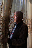 "China - Ningxia - Wang Fengyu, 74 years old. A former agriculture technician and the co-founder of Helan Qingxue Vineyard, Wang is extremely confident in the future of the region. ""In ten years from now our wines will be on a par with top brands from Bordeaux and Burgundy"", he assures. ""Ningxia has great potential""."