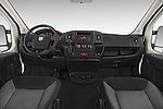 Stock photo of straight dashboard view of2014 Ram Promaster 1500 136 WB Low Roof 3 Door Cargo Van Dashboard