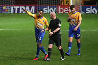 Mansfield's Krystian Pearce speaks to referee, Kevin Johnson, after he allowed Charlton's third goal to stand. Mansfield players believed a free-kick should have been awarded to them moments earlier during Charlton Athletic vs Mansfield Town, Emirates FA Cup Football at The Valley on 20th November 2018