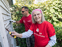 United Way volunteers from Suncor and Imperial Oil spent the best part of a day scraping and painting and doing yard work for Sarnia artist Jessie Rabbitt<br /> The &lsquo;Day of Caring&rsquo;, now in its 24th year, is the biggest one day volunteer event in Sarnia-Lambton.  <br /> The work at individuals&rsquo; homes to be completed this year will include cleaning eaves troughs,  painting, repairing damaged walls from wheelchairs, yard work, cleaning windows, replacing doors, installing handrails, and other home maintenance.