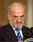 Washington, D.C. - June 24, 2005 -- Prime Minister Ibrahim al-Jaafari of Iraq listens to a reporter's question during a joint press conference with United States President George W. Bush in the East Room at the White House in Washington, D.C. on June 24, 2005.  They discussed the re-building of Iraq and refused to give a time-table for the withdrawal of United States forces.<br /> Credit: Ron Sachs / CNP