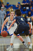 NWA Democrat-Gazette/CHARLIE KAIJO Rogers High School guard London Hatch (20) drives the ball down the court as Bentonville West High School guard Kelsie Mahone (4) covers during a basketball game, Friday, February 8, 2019 at Rogers High School in Rogers.