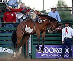 Taos Muncy competes in the saddle bronc riding event at the Reno Rodeo in Reno, Nev., on Friday, June 20, 2014.<br />