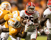 KNOXVILLE, TN - OCTOBER 5: Brian Herrien #35 of the Georgia Bulldogs is tackled by Matthew Butler #94 of the Tennessee Volunteers during a game between University of Georgia Bulldogs and University of Tennessee Volunteers at Neyland Stadium on October 5, 2019 in Knoxville, Tennessee.