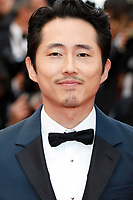 "Steven Yeun at the ""Burning"" premiere during the 71st Cannes Film Festival at the Palais des Festivals on May 16, 2018 in Cannes, France. Credit: John Rasimus / Media Punch ***FRANCE, SWEDEN, NORWAY, DENARK, FINLAND, USA, CZECH REPUBLIC, SOUTH AMERICA ONLY***"