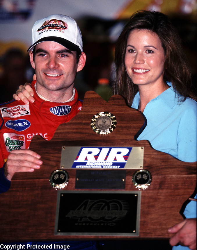 Jeff Gordon celebrates with his wife , Brooke, after winning  Chevrolet Monte Carlo 400 NASCAR Winston Cup race at Richmond International Raceway in Richmond, VA on Saturday night, 9/9/00.  (Photo by Brian Cleary)