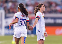, FL - : Margaret Purce #30 high fives Tobin Heath #17 of the United States during a game between  at  on ,  in , Florida.