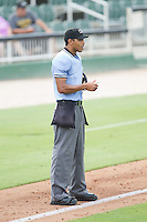 Home plate umpire Ronnie Whiting updates his lineup card as the Lakewood BlueClaws make a pitching change during the game against the Kannapolis Intimidators at CMC-NorthEast Stadium on July 20, 2014 in Kannapolis, North Carolina.  The Intimidators defeated the BlueClaws 7-6. (Brian Westerholt/Four Seam Images)