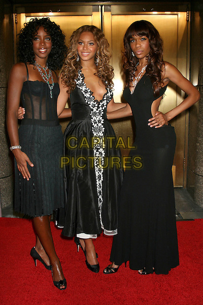 KELLY ROWLAND, BEYONCE KNOWLES & MICHELLE WILLIAMS (DESTINY'S CHILD).Arrivals at Fashion Rocks held at Radio City Music Hall,.New York, 8th September 2005.full length black dress long corset top hand hip.Ref: IW.www.capitalpictures.com.sales@capitalpictures.com.©Capital Pictures