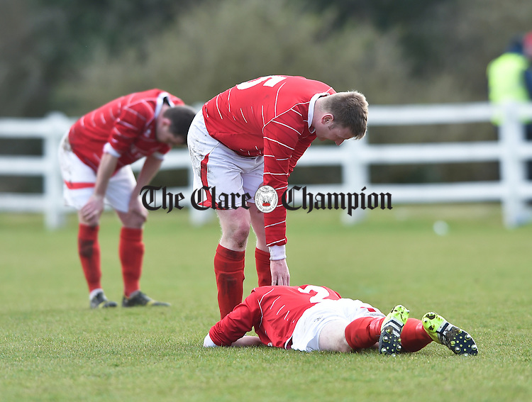 Newmarket Celtic's mark Donlon consoles team mate David O Grady following the loss to Janesboro in their Munster League Champions Trophy final at The County Grounds, Doora. Photograph by John Kelly.