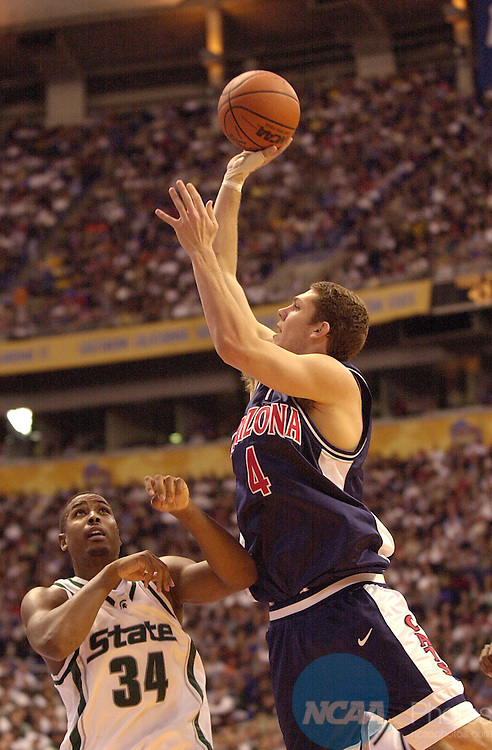 31 MAR 2001:  University of Arizona forward Luke Walton (4) shoots the ball over Michigan State forward Andre Hutson (34) during the Division 1 semifinal game of the Men's Final Four Basketball Championship held at the Hubert H. Humphrey Metrodome in Minneapolis, MN. Arizona defeated Michigan St. 80-61 to advance to the Championship game. Ryan McKee/NCAA Photos.DIGITAL IMAGE ONLY