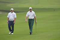George Coetzee and Ernie Els (RSA) walk to the 9th green during Saturay's Round 3 of the 2014 BMW Masters held at Lake Malaren, Shanghai, China. 1st November 2014.<br /> Picture: Eoin Clarke www.golffile.ie