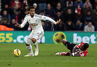 Pictured: Kyle Naughton of Swansea (L) Sunday 01 February 2015<br /> Re: Premier League Southampton v Swansea City FC at ST Mary's Ground, Southampton, UK.