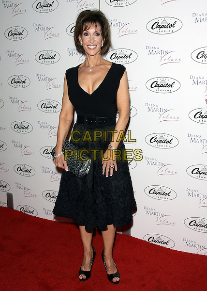 "DEANA MARTIN.Deana Martin CD release party""  held  at  Capitol Studios, Hollywood, California, USA..September 9th, 2009.full length black dress clutch bag sleeveless silver .CAP/ADM/TC.©T. Conrad/AdMedia/Capital Pictures."
