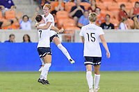 Houston, TX - Thursday Aug. 18, 2016: Christine Nairn celebrates scoring, Victoria Huster during a regular season National Women's Soccer League (NWSL) match between the Houston Dash and the Washington Spirit at BBVA Compass Stadium.