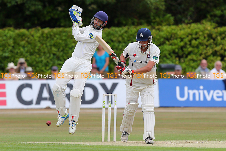 Essex wicket keeper James Foster leaps as Kent batsman Rob Key leaves a bouncing delivery