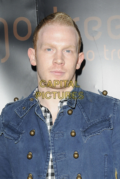 BB9'S REX NEWMARK.The Thai New Year Party, Mango Tree restaurant, Grosvenor Place, London, England..April 14th, 2010.headshot portrait denim jean jacket gold buttons .CAP/CAN.©Can Nguyen/Capital Pictures.