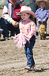 Julianna Baltes of Fernley competes in the Pee-Wee Stick Horse Barrel Racing event at the Fallon Junior Rodeo.  Photo by Tom Smedes.