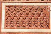 Agra fort, Utar Pradesh, India. Red sandstone inlaid decorative panel with geometric design of interlocking dodecagons (twelve-sided shapes)