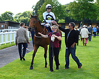 Connections of Gold Hunter greet jockey Joshua Bryan in the winners enclosure during Afternoon Racing at Salisbury Racecourse on 13th June 2017