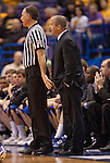 March 5,  2010               Drake head coach Mark Phelps has the referee's ear during the first half, as the ref motions Phelps back.  The University of Northern Iowa Panthers played the Drake University Bulldogs in Game 3 of the Missouri Valley Conference Tournament at the Scottrade Center in downtown St. Louis, MIssouri on Friday March 5, 2010.  The Bulldogs advanced to play the Panthers on the second day of competition after defeatiing the Southern Illinois University-Carbondale Salukis in Game 1.