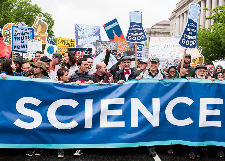 UNITED STATES - APRIL 22: Marchers, including Bill Nye the Science Guy, center, lead the March for Science down Constitution Avenue in Washington on Earth Day, Saturday, April 22, 2017. Thousands of pro-science and environmental activists rallied on the National Mall before marching towards the Capitol. (Photo By Bill Clark/CQ Roll Call)