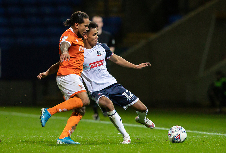 Bolton Wanderers' Adam Chicksen  competing with Blackpool's Sean Scannell (left) <br /> <br /> Photographer Andrew Kearns/CameraSport<br /> <br /> The EFL Sky Bet League One - Bolton Wanderers v Blackpool - Monday 7th October 2019 - University of Bolton Stadium - Bolton<br /> <br /> World Copyright © 2019 CameraSport. All rights reserved. 43 Linden Ave. Countesthorpe. Leicester. England. LE8 5PG - Tel: +44 (0) 116 277 4147 - admin@camerasport.com - www.camerasport.com