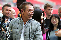 Peter Lim, one of Singapore's leading stockbrokers and an investor in Salford City celebrates on the pitch at the end of the match during AFC Fylde vs Salford City, Vanarama National League Football Promotion Final at Wembley Stadium on 11th May 2019