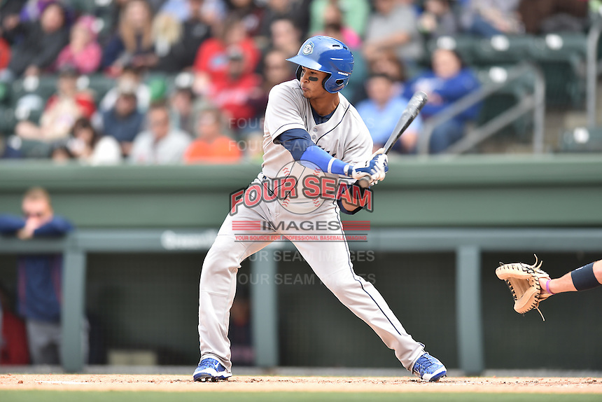 Asheville Tourists third baseman Jonathan Piron (9) swings at a pitch during a game against the  Greenville Drive at Fluor Field on April 10, 2016 in Greenville South Carolina. The Drive defeated the Tourists 7-4. (Tony Farlow/Four Seam Images)