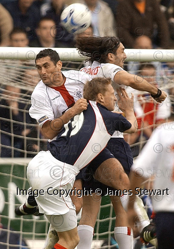11/09/2005         Copyright Pic : James Stewart.File Name : jspa23 falkirk v rangers.FALKIRK'S DANIEL MCBREEN CHALLENGES FOR THE BALL WITH JULIEN RODRIGUEZ AND SOTIRIOS KYRGIAKOS....Payments to :.James Stewart Photo Agency 19 Carronlea Drive, Falkirk. FK2 8DN      Vat Reg No. 607 6932 25.Office     : +44 (0)1324 570906     .Mobile   : +44 (0)7721 416997.Fax         : +44 (0)1324 570906.E-mail  :  jim@jspa.co.uk.If you require further information then contact Jim Stewart on any of the numbers above.........