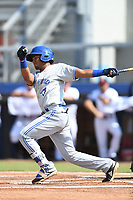 Leonardo Jimenez (10) of the Bluefield Blue Jays follows through on his swing during a game against the Danville Braves at American Legion Post 325 Field on July 28, 2019 in Danville, Virginia. The Blue Jays defeated the Braves 9-7. (Tracy Proffitt/Four Seam Images)