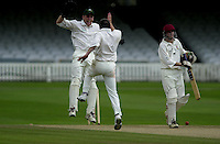 Photo Peter Spurrier.01/09/2002.Village Cricket Final - Lords.Elvaston C.C. vs Shipton-Under-Wychwood C.C..Shiptons wicketkeeper, Shane Duff, and Bowler Phil Garner celebrate Garner's dismissal ofElvaston's Lee Archer.