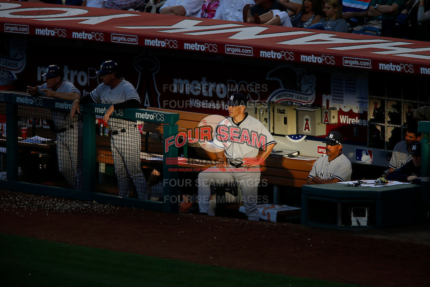 New York Yankees Manager Joe Girardi #28 watches from the dugout  a game against the Los Angeles Angels at Angel Stadium on June 15, 2013 in Anaheim, California. (Larry Goren/Four Seam Images)