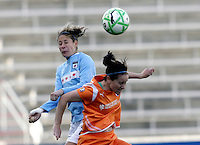 Chicago Red Star defender Marian Dalmy (2) battles for a head with Sky Blue FC midfielder Collette McCallum (14).  The Sky Blue FC defeated the Chicago Red Stars 2-0 at Toyota Park in Bridgeview, IL on May 10, 2009.