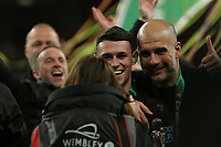 Phil Foden of Manchester City and Pep Guardiola have there picture taken.  Aston Villa vs Manchester City, Caraboa Cup Final Football at Wembley Stadium on 1st March 2020