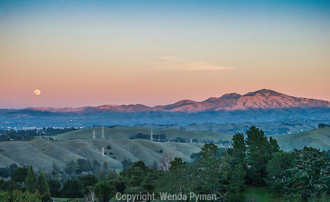Full moon rises over Mount Diablo and foothills as seen from Mulholland Ridge