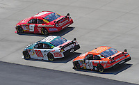 Jun 1, 2008; Dover, DE, USA; NASCAR Sprint Cup Series driver Kasey Kahne (9) leads Dale Earnhardt Jr (88) and Tony Stewart (20) during the Best Buy 400 at the Dover International Speedway. Mandatory Credit: Mark J. Rebilas-US PRESSWIRE