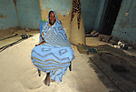 Mariam Mohammed is a woman who fled Timbuktu, a city in northern Mali, when it was seized by Islamist fighters in 2012. She returned home in May, 2013, after the city and region had been liberated by French and Malian soldiers. Here she sits in her one-room home in Timbuktu.