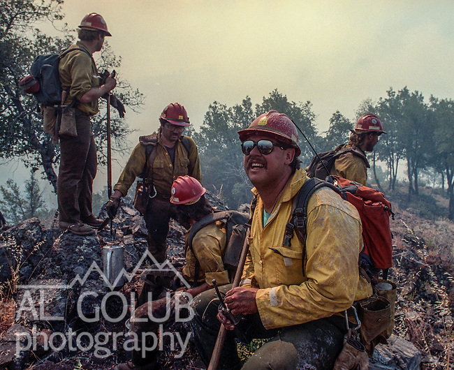 "September 15, 1990 Tuolumne City, California -- Cottonwood Fire -- Stanislaus Hotshot superintendent Greg ""Rax"" Overacker gets his crew ready to head down the Hacienda fuel break to check for spot fires and burn a strip between the active fire and the break.  The Cottonwood Fire was held to 2,000 acres by the fast action of fire crews.  The fire threatened several small communities. The big challenge was to make sure the fire didn't get past the Hacienda fuel break, keeping the fire out of the Tuolumne River."