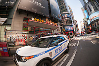 An NYPD vehicle in New York parked in front of subway entrance in Times Square on Tuesday, March 22, 2016. Security in New York has been heightened in the wake of the terrorist bombings in Brussels, Belgium. (© Richard B. Levine)