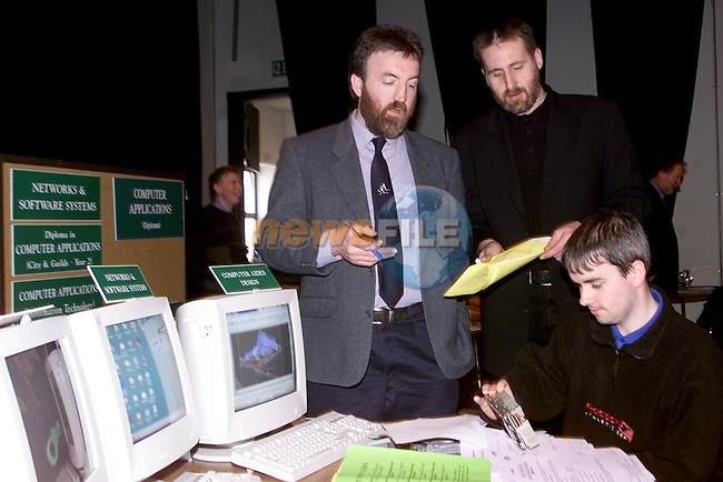 Chris Honan and Ray Donagh, Information Technology teachers with Patrick Traynor from Donnycarney at the Drogheda College of Further Education Information Day in the Droichead Arts Centre..Picture Paul Mohan Newsfile