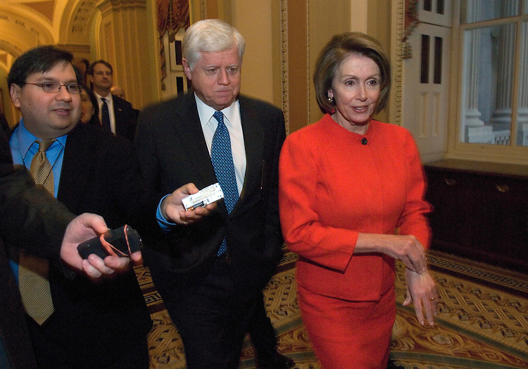 Speaker Nancy Pelosi, D-Calif., along with Caucus Vice Chairman John Larson, D-Conn., make their with other members of the House democratic leadership to a meeting with Senate Majority Leader Harry Reid, D-Nev.