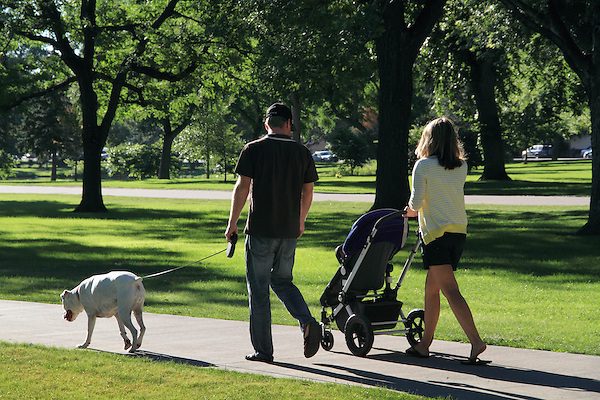 Parents with baby stroller and walking the dog, Denver, Colorado. .  John offers private photo tours in Denver, Boulder and throughout Colorado. Year-round Colorado photo tours.